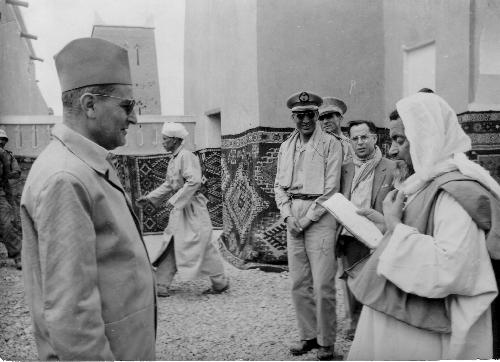 The King of Morocco (left), Mohammed V speaking with one of his subjects in 1957.jpg
